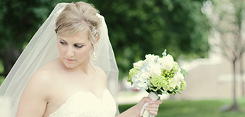 Bride in wedding dress with flowers.