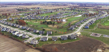 Aerial view of neighborhood with houses.