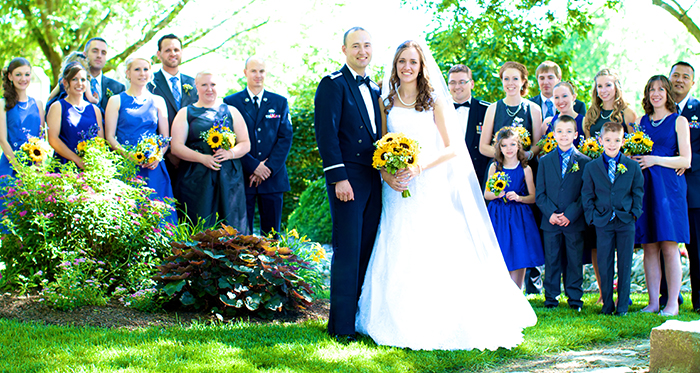 Portrait of wedding party outside.